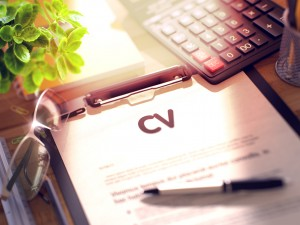CV on Clipboard. Composition on Working Table and Office Supplies Around. Business Concept - CV on Clipboard. Composition with Office Supplies on Desk. 3d Rendering. Blurred Image.